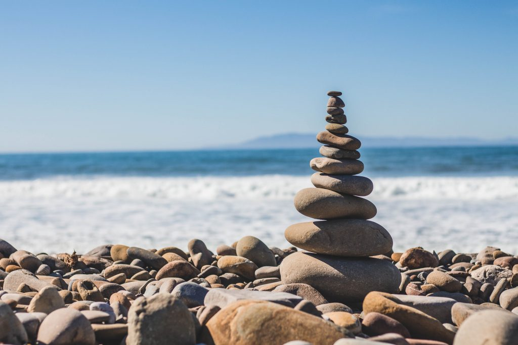 zen like pile of stones on a beach