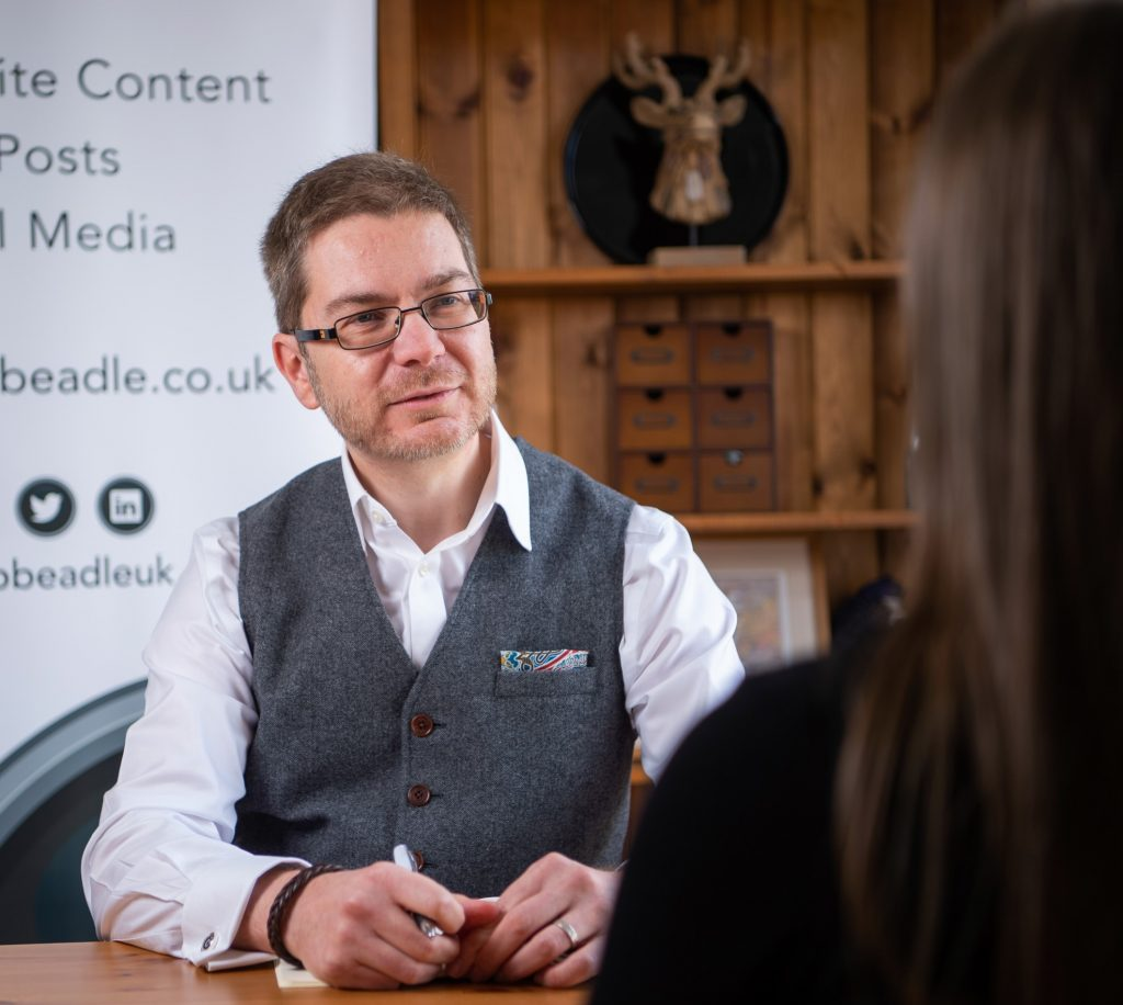 Rob Beadle talking to a client